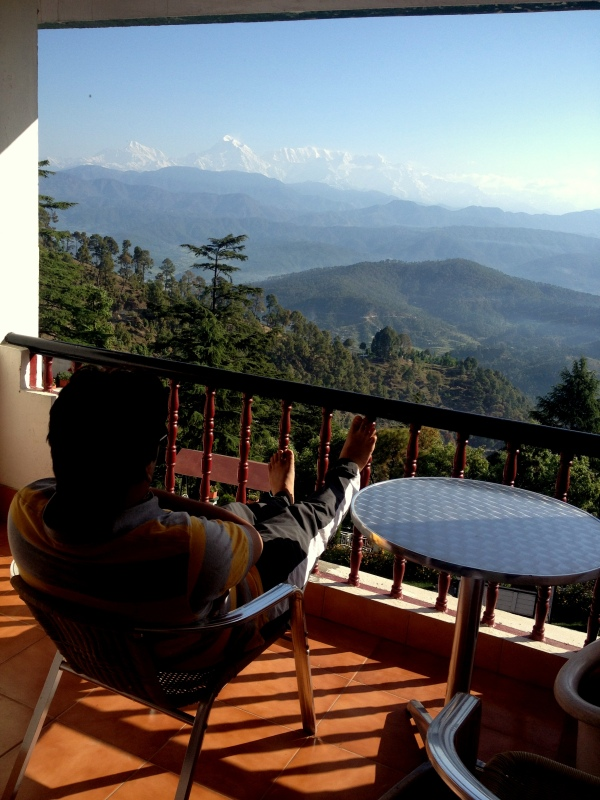 Hubs taking in the view from our balcony in Kausani!